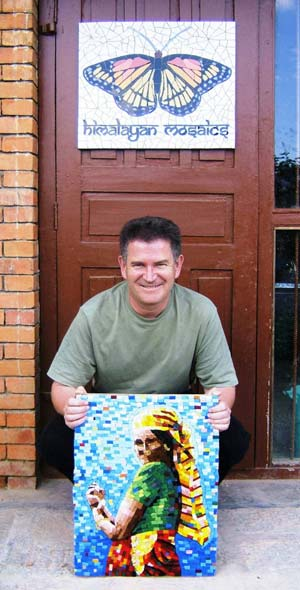 Philip Holmes holding a mosaic